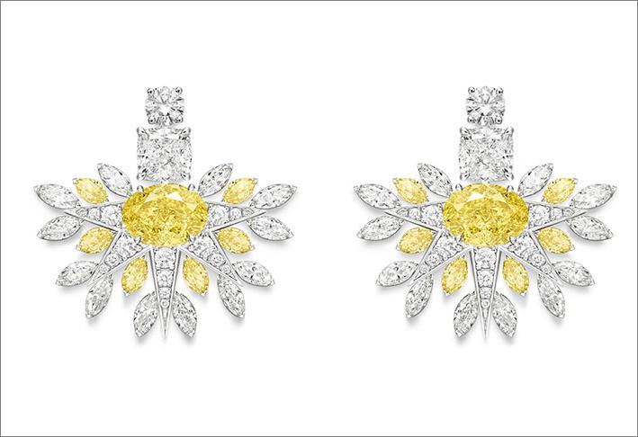 Rising Star Earrings, 18K white gold earrings set with 2 oval-cut fancy vivid yellow diamonds (approx. 1.50 ct and 1.40 ct), 2 cushion-cut diamonds (approx. 0.96 ct and 0.95 ct), 12 marquise-cut yellow diamonds (approx. 1.44 ct), 24 marquise-cut diamonds (approx. 1.68 ct) and 34 brilliant-cut diamonds (approx. 0.94 ct)