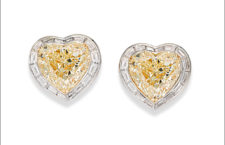 White and yellow gold earrings. White gold fancy yellow diamond (19.92 ct) and diamond (4.48 ct) earrings set in white and yellow gold