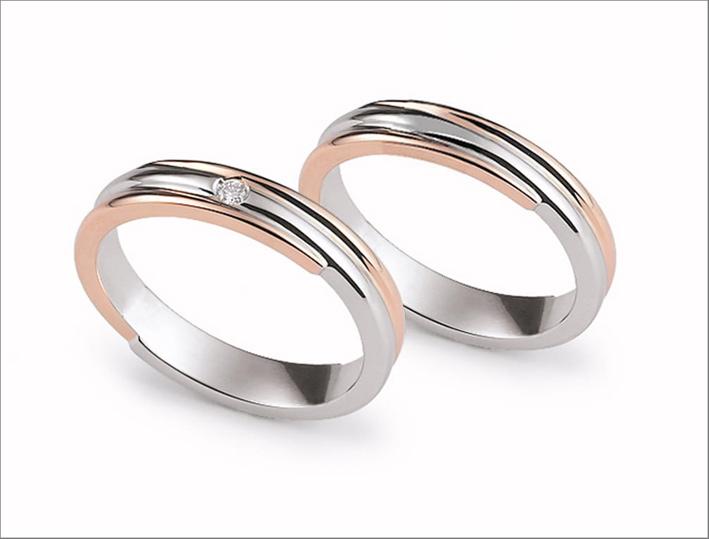 Fedi intrecciate in oro bianco e oro rosa e bianco, con diamante