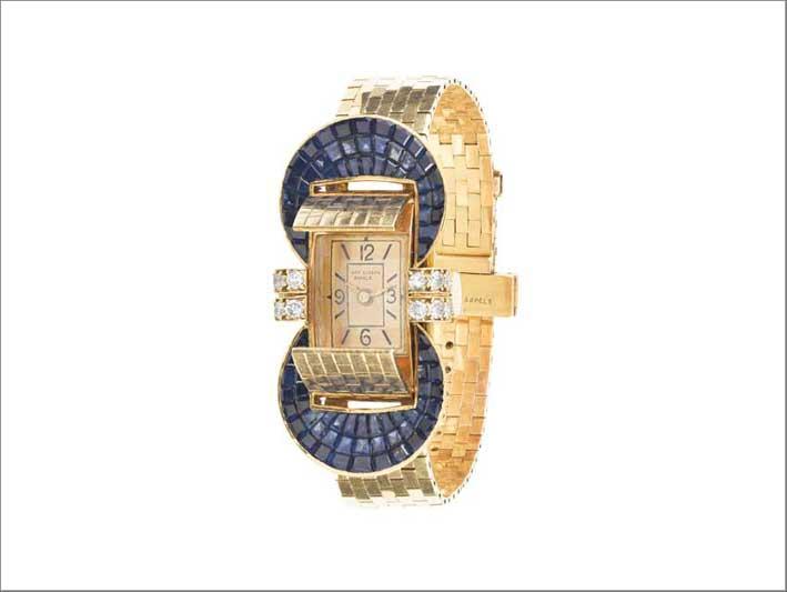 Bracciale orologio Ludo à volets, 1949 Oro giallo, Serti Mystérieux zaffiri, diamanti