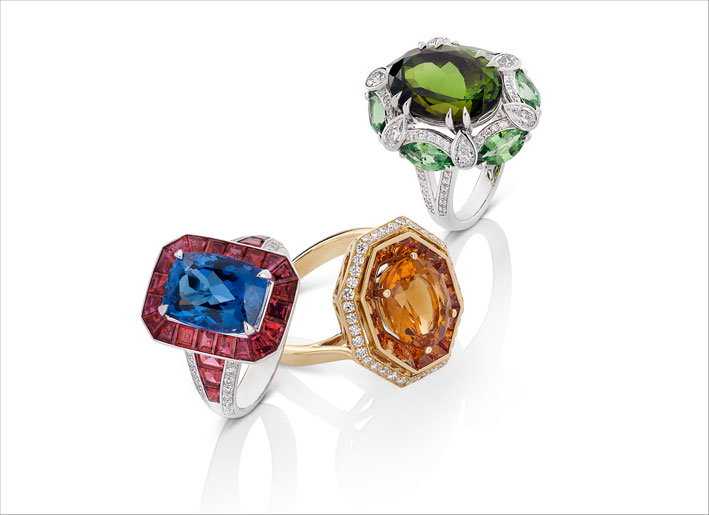 White gold ring with tanzanite, rubies and white diamonds. Yellow gold ring with citrine, orange sapphires and white diamonds. White gold ring with green tourmaline, natural green garnet and white diamonds