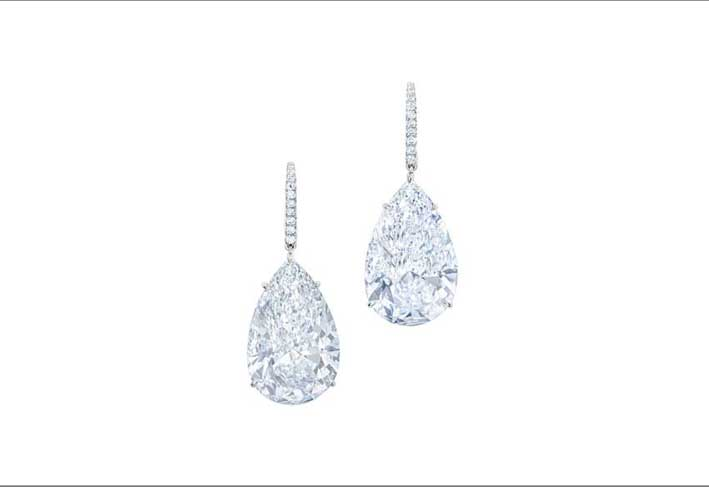 A pair of pear-shaped, D colour, flawless diamond earrings, weighing 12.71 and 2.07 carats
