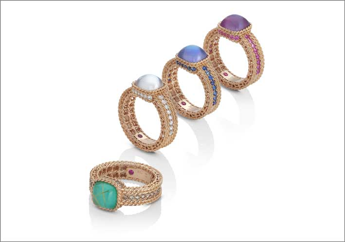Rose gold rings with triplets of amethyst, mother of pearl and carnelian with pink sapphires; amethyst, mother of pearl and lapis lazzuli with blue sapphires; white quartz and mother of pearl doublet with white diamonds and a triplet of rutilated quartz, turquoise and mother of pearl with brown diamonds.