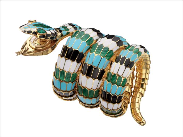 Serpenti bracelet-watch in gold with polychrome enamel and emeralds, ca. 1967