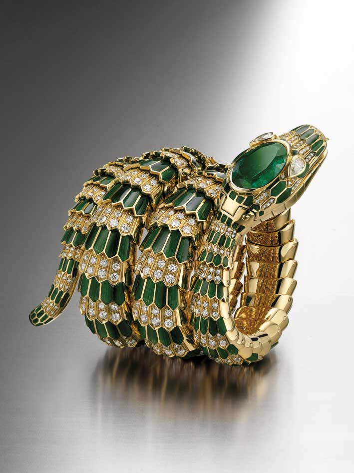 Serpenti bracelet-watch in gold with green enamel, emerald and diamonds, ca. 1965