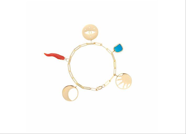 Bracciale in oro con simboli portafortuna