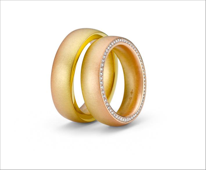 Anelli della collezione Solaris in oro giallo e rosso, diamanti