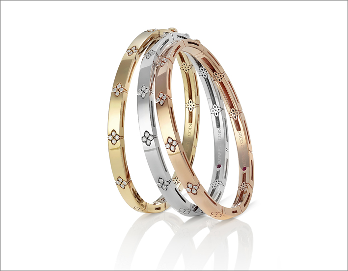 Yellow, white and rose gold bangles with diamonds