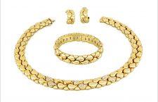 Parure di Chopard, collezione Casmir, in oro giallo 18 carati e diamanti