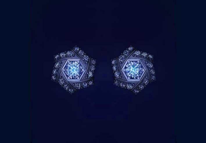 Orecchini in oro bianco e diamanti di Luminous Diamonds con effetto fluo