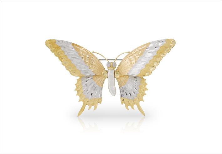 Spilla in oro giallo e bianco con diamanti e perla barocca al centro